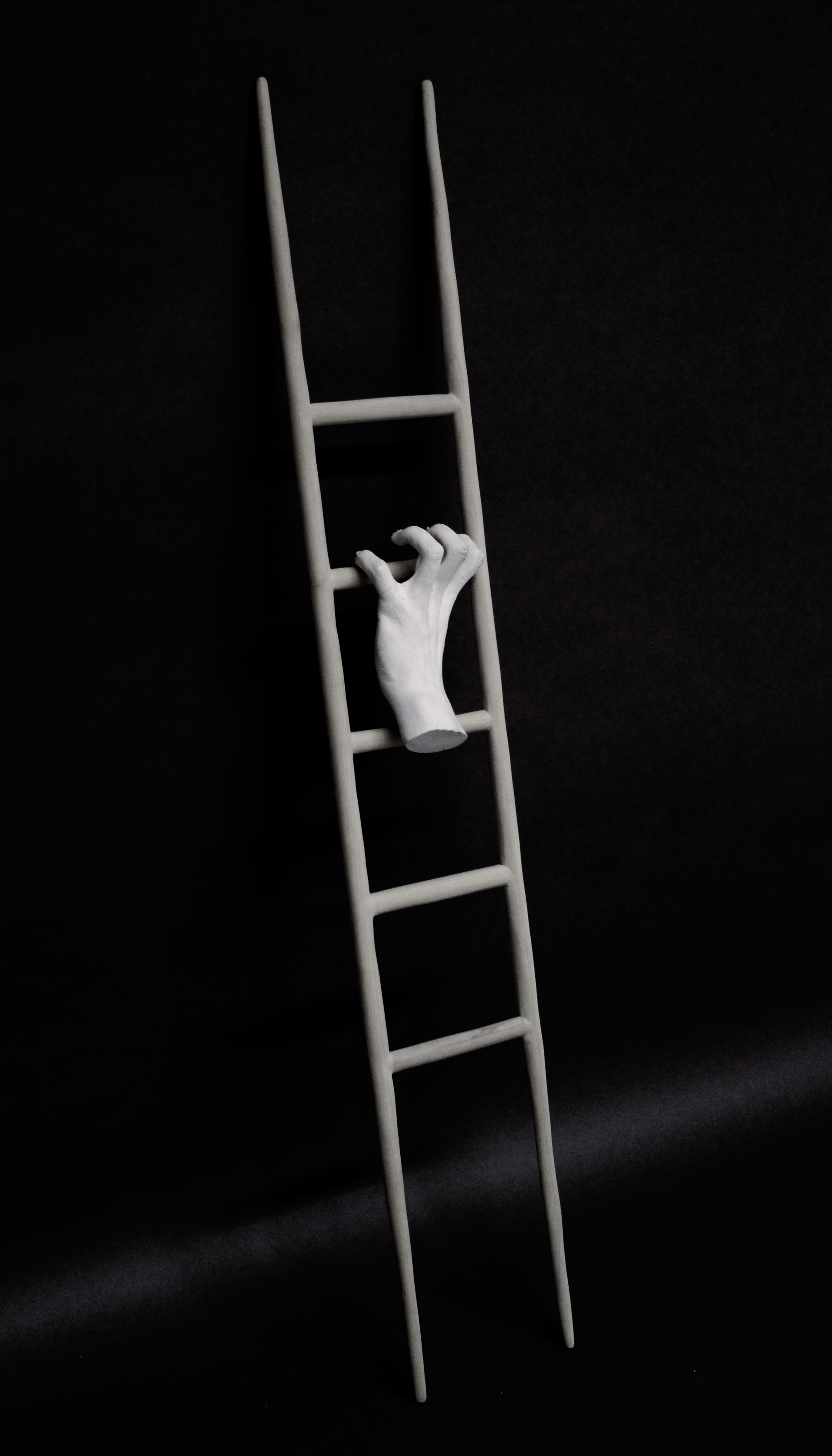 sculpture wood ladder hand ascension American dream commentary