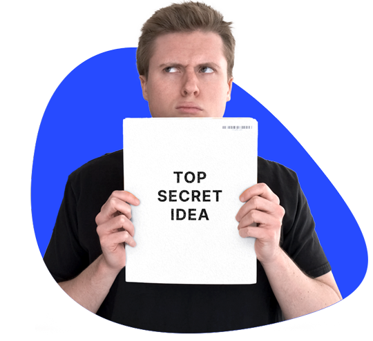 "A picture of Aaron Ward holding a book that says ""Top Secret Idea"""