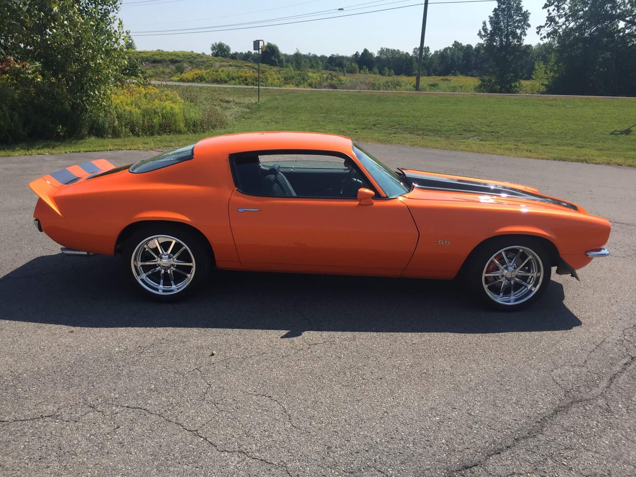 side view of orange 1970 camaro rs/ss