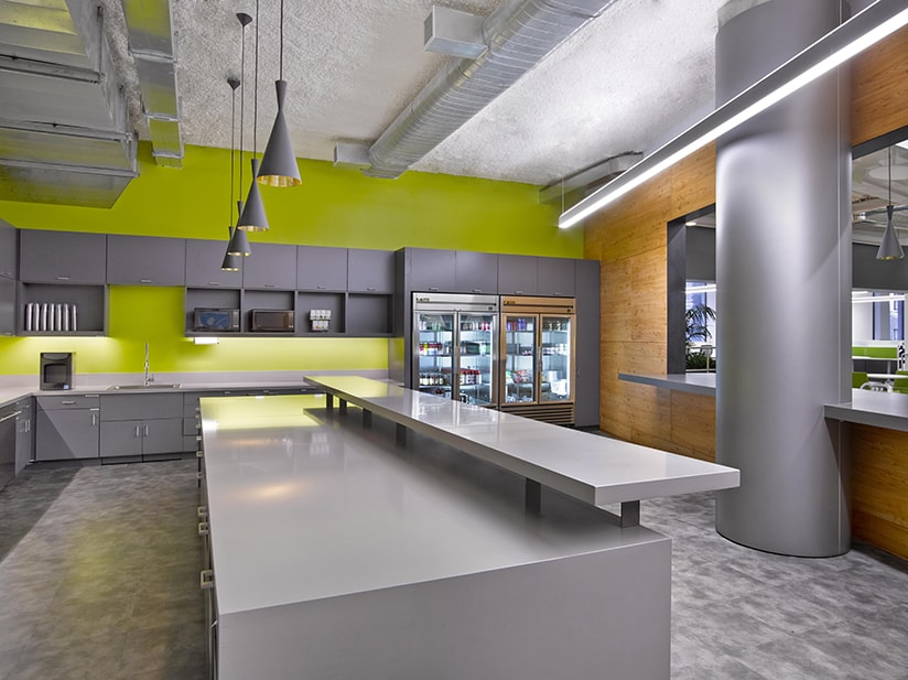 The offices for Rocket Fuel in Manhattan posed an interesting challenge as the artificial intelligence marketing company was growing so quickly, the location and size of the project changed several times during the design process. The resulting design is a dynamic juxtaposition of elements from the SF Headquarters to remain on brand while incorporating new materials and forms to celebrates the unique New York location. A bright color palette was utilized to accentuate the unique departments and sub- group within the space.