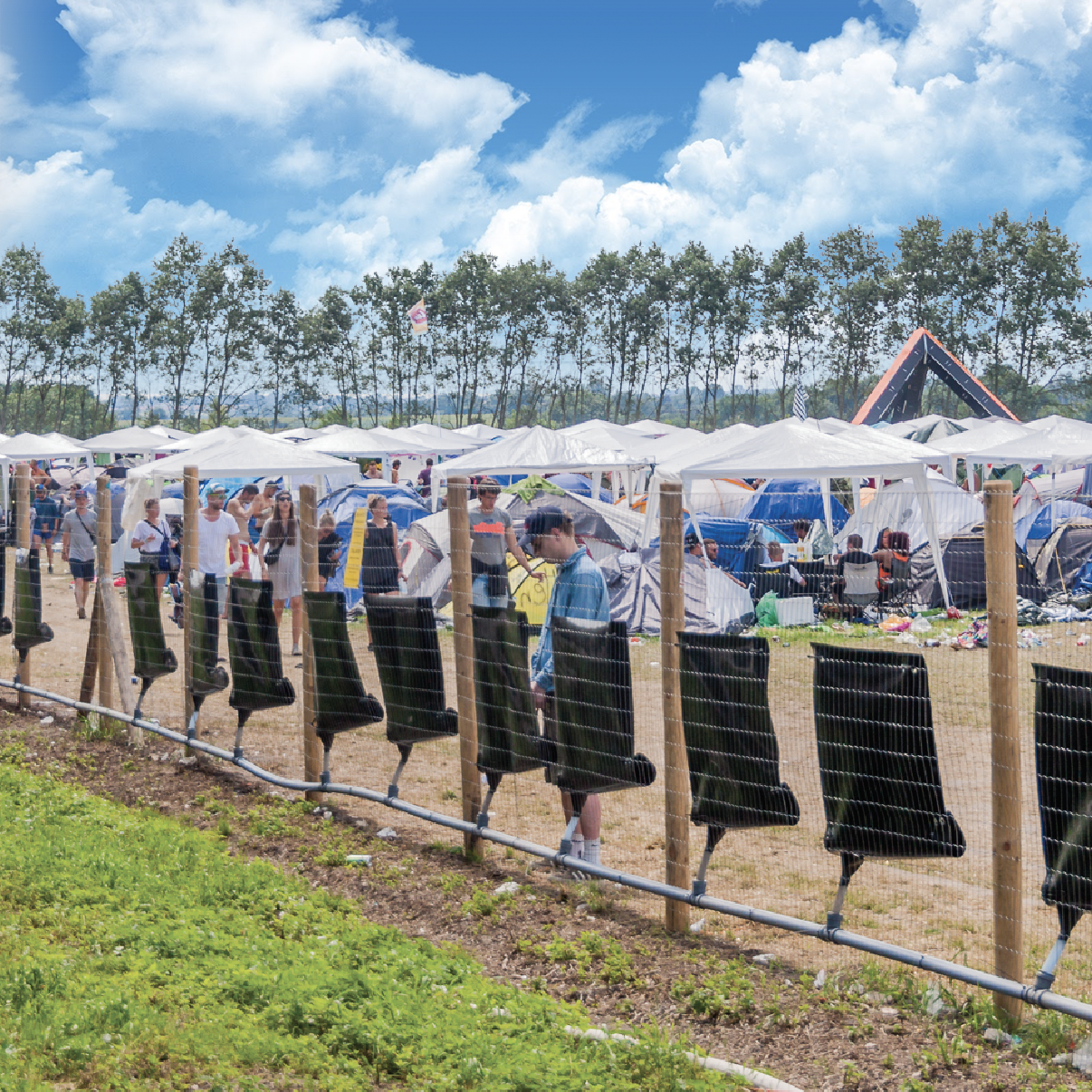 Photo of Peefence urinals on the fence at Roskilde Festival