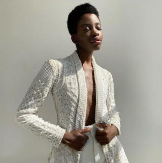 Model wearing a Khanum's jacket in  ivory