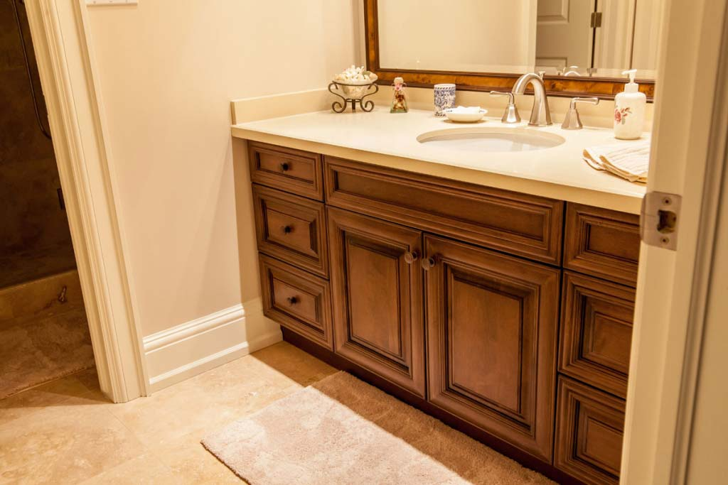 1 Traditional custom vanity with dark wood cabinets.