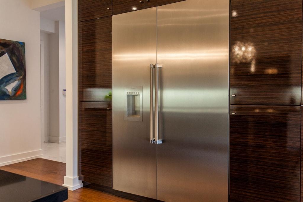 Ultra modern white kitchen with zebrawood gloss island and fridge cabinets