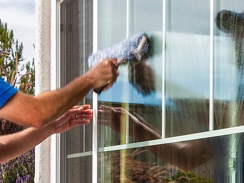 Cleaning a window in Evansville IN