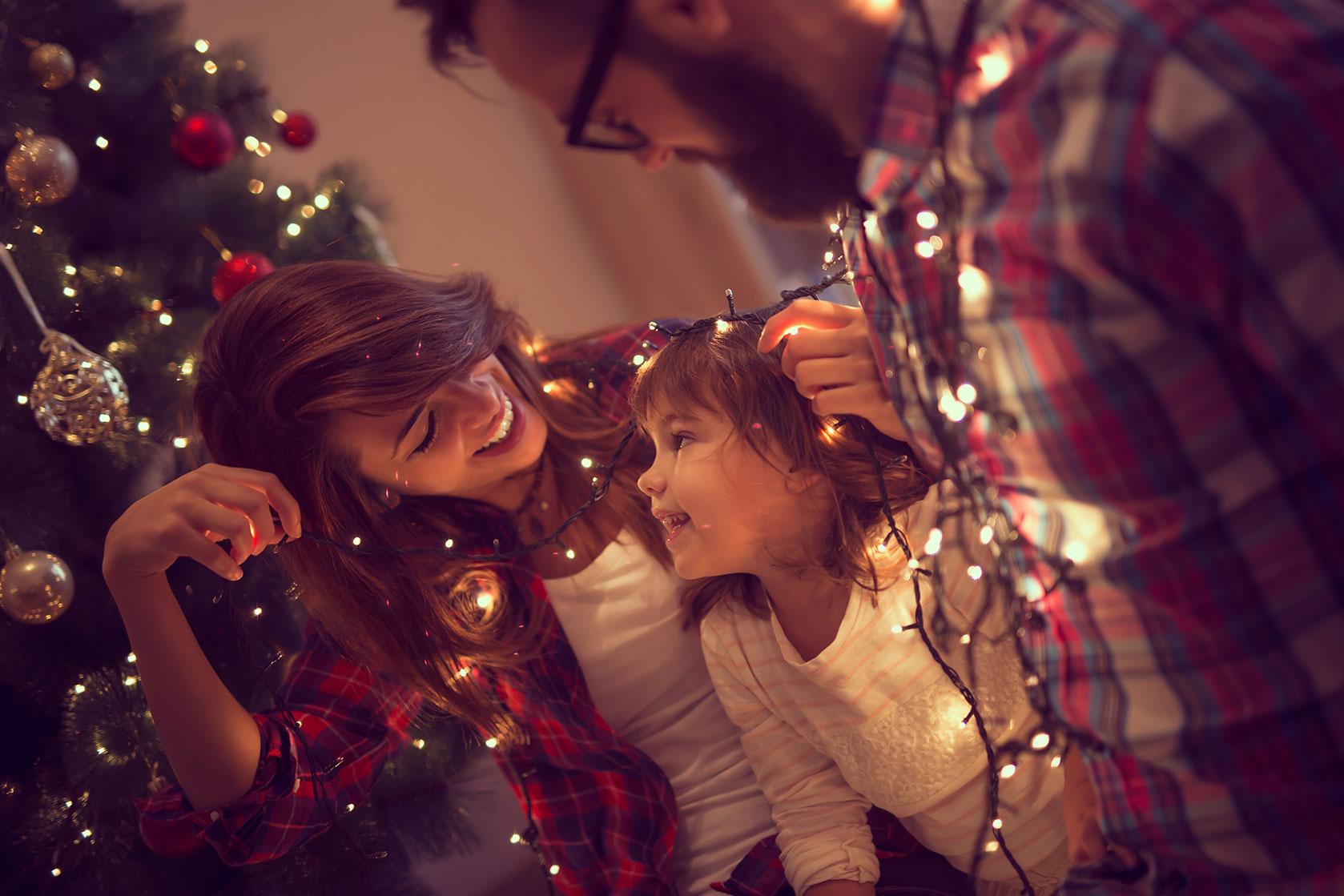 Happy family around a Christmas tree