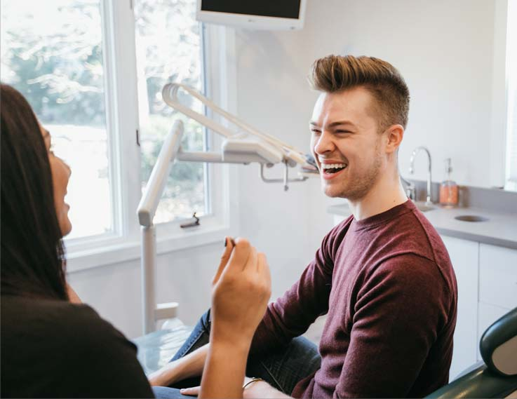 Photo of a male patient smiling at Dr. Cheung