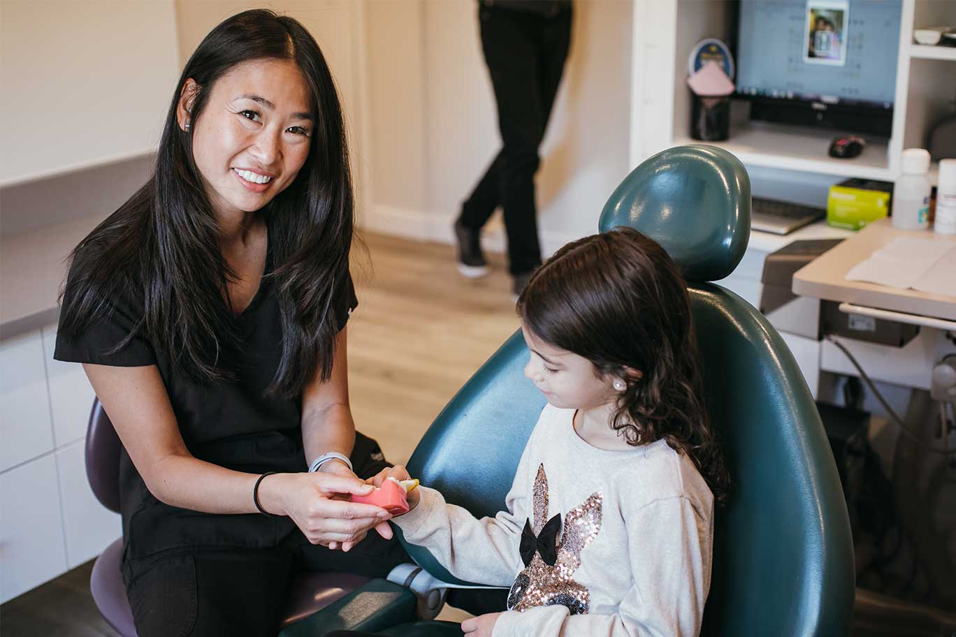 Photo of Dr. Elke Cheung with a young patient
