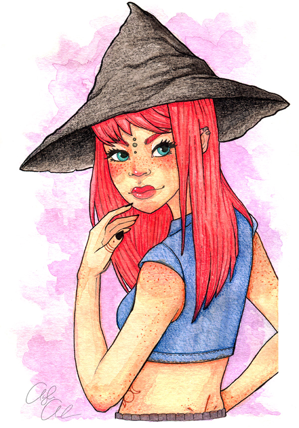 A girl in a witch hat with bright red hair and lots of freckles.