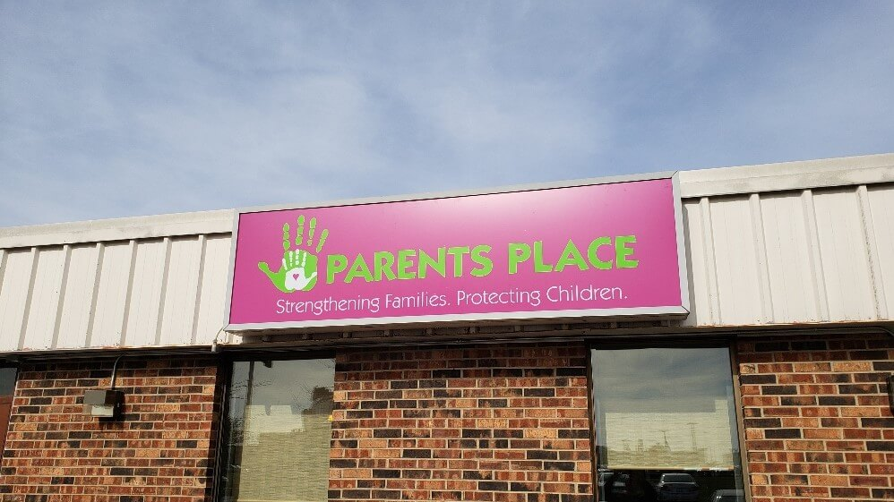 A parents place outdoor sign
