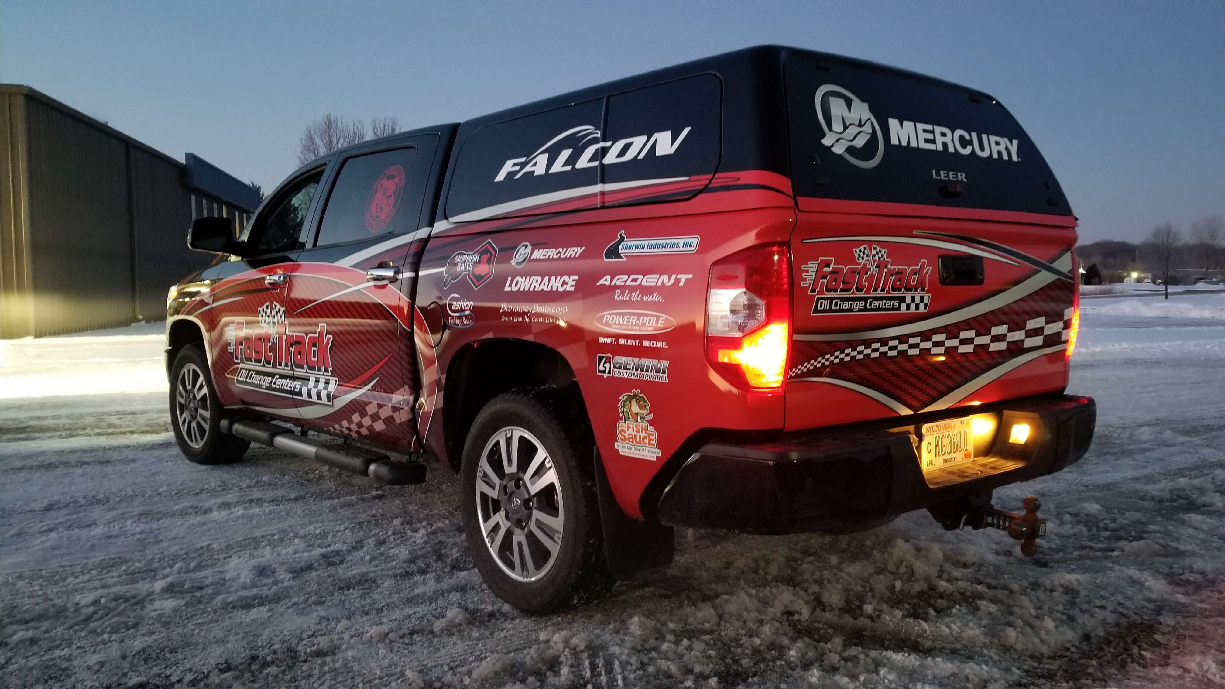 Fast Track truck full wrap with company information