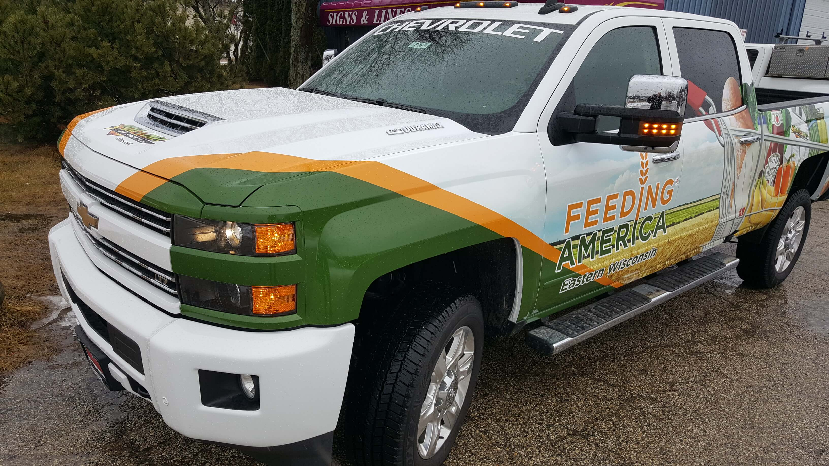 Feeding America Signs and Lines Chevy Wrap