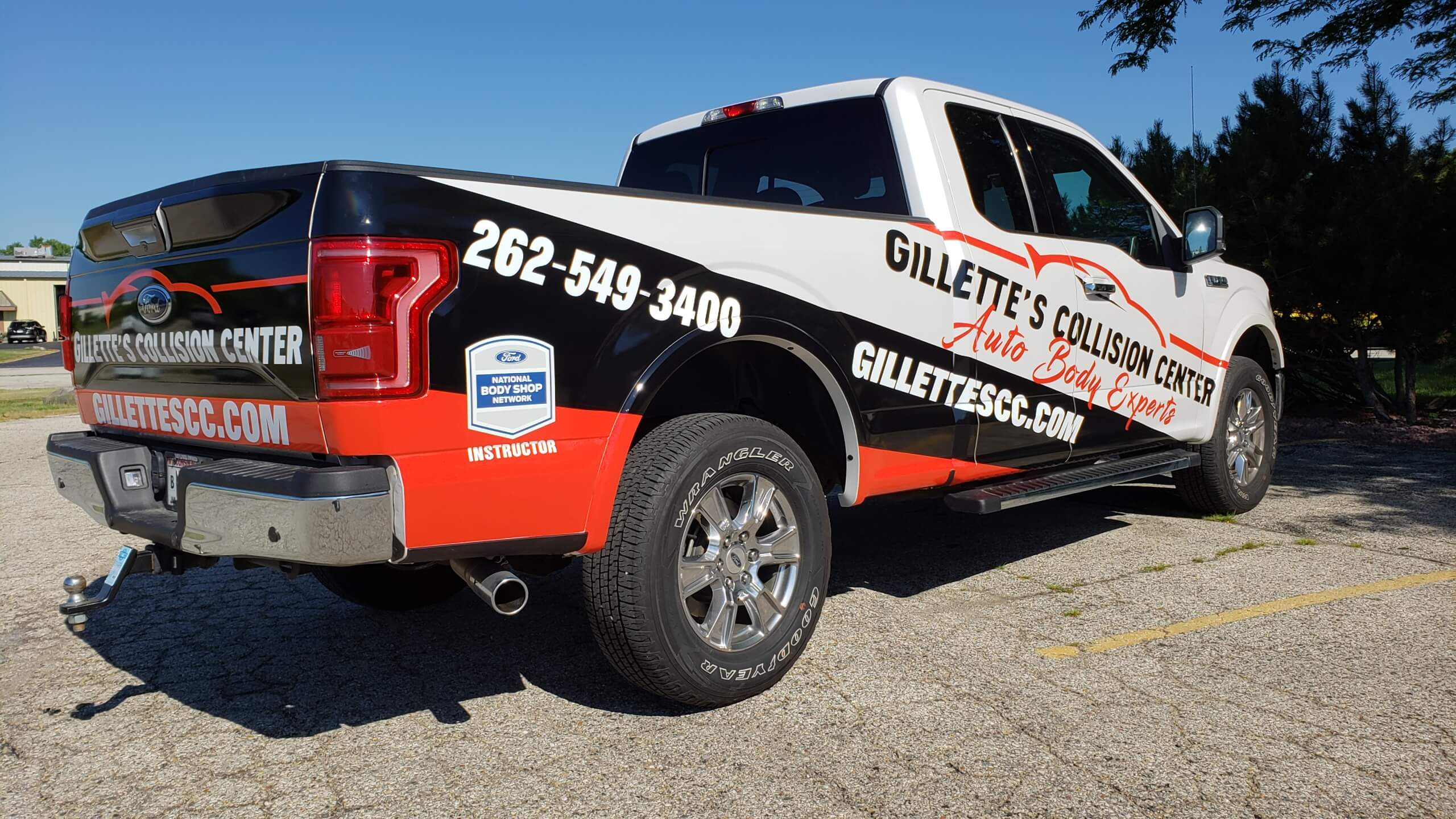 Red, White, and Black truck with vinyl graphics