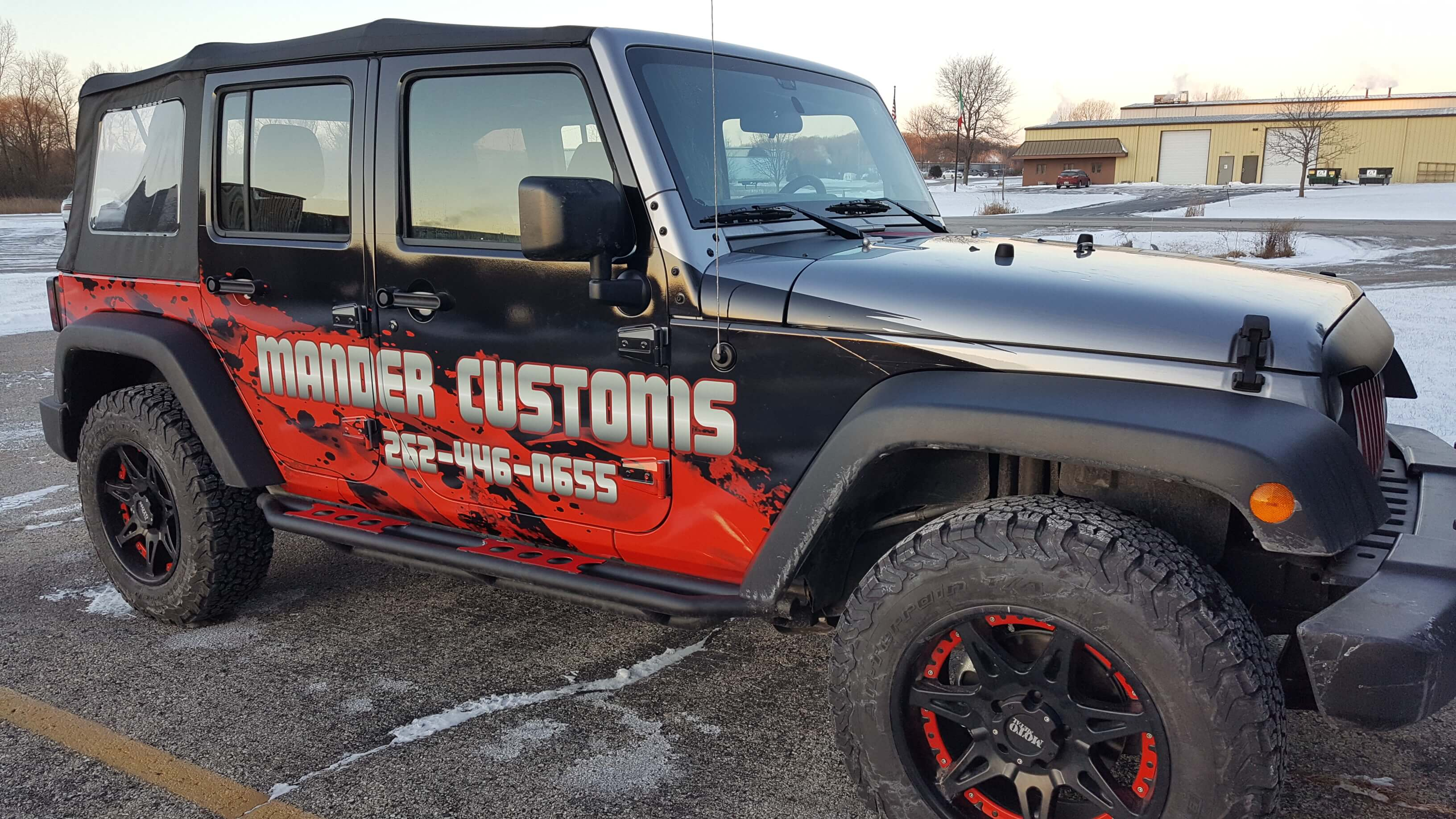 Mander Collision Black and Red Jeep
