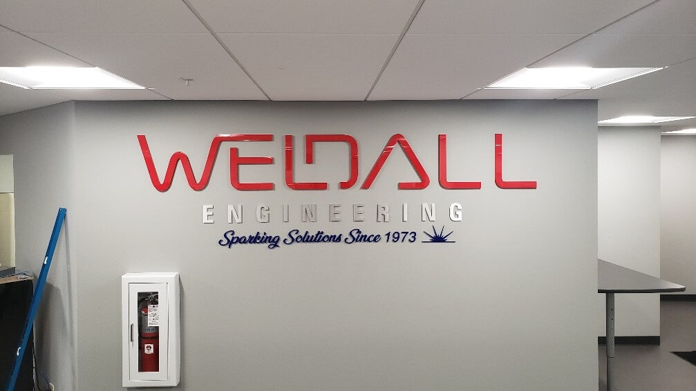 Weldall interior lobby sign by Signs and Lines