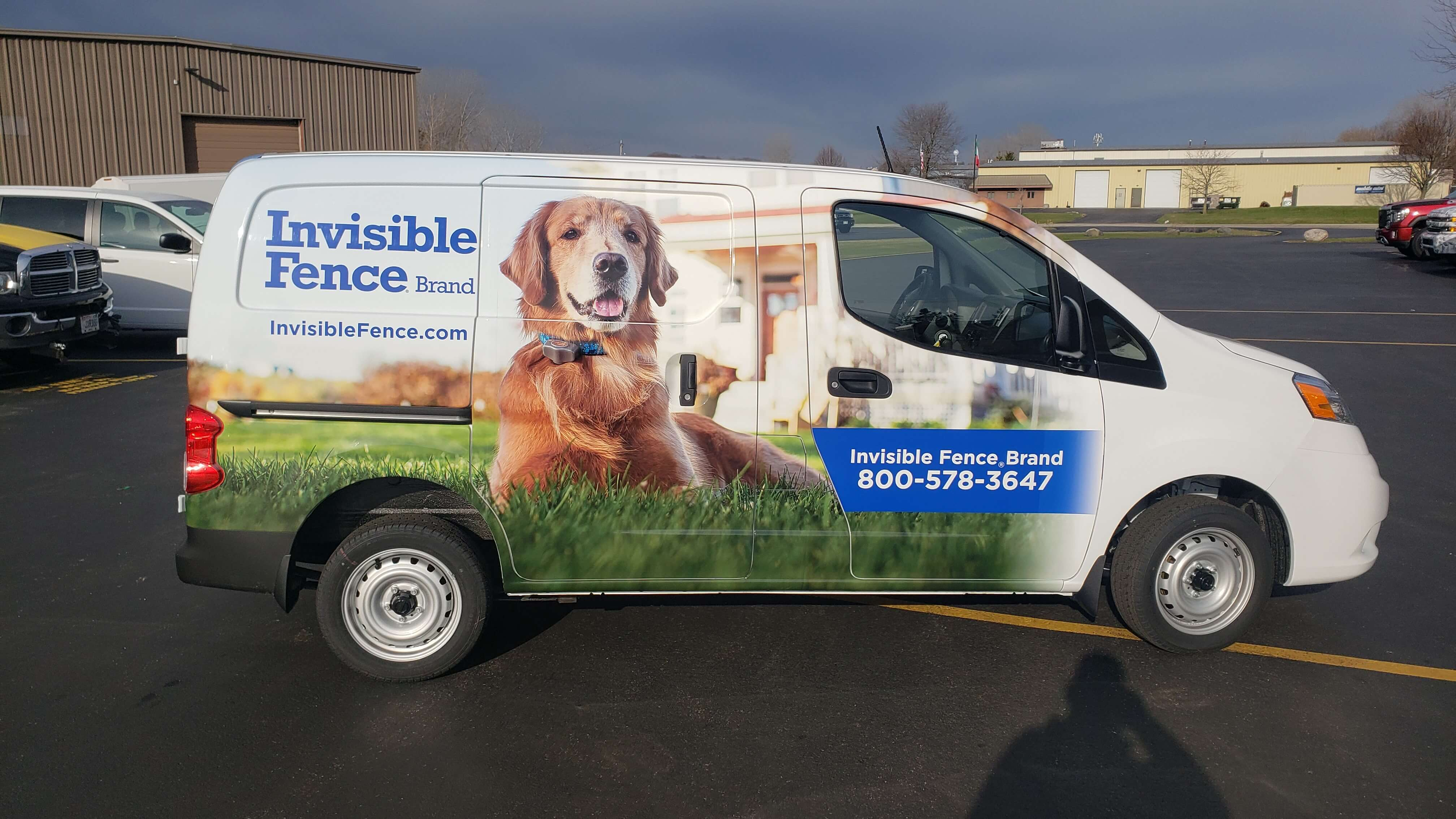 Invisible Fence Fleet Van Wrap by Signs and Lines