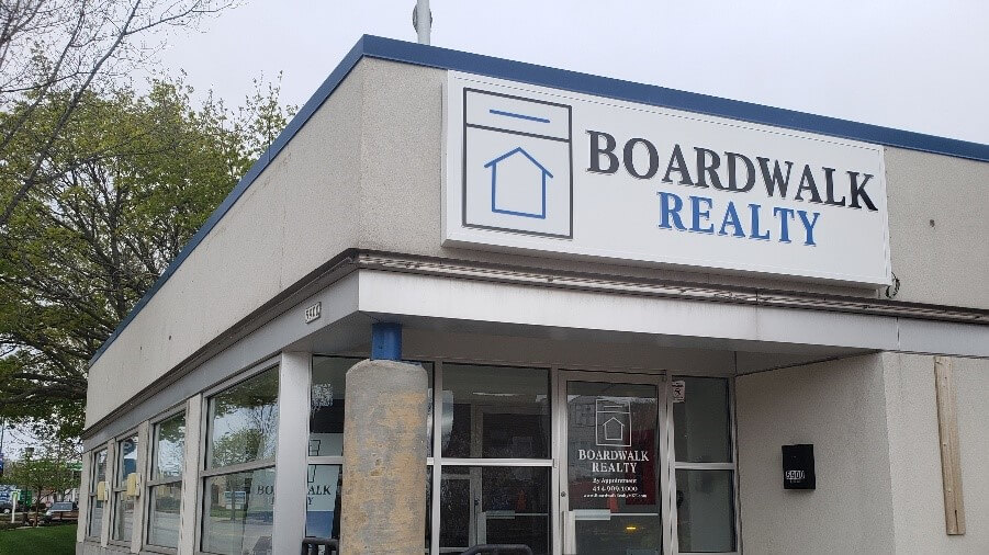 Boardwalk realty outdoor, lit cabinet sign during the daytime in their West Allis location