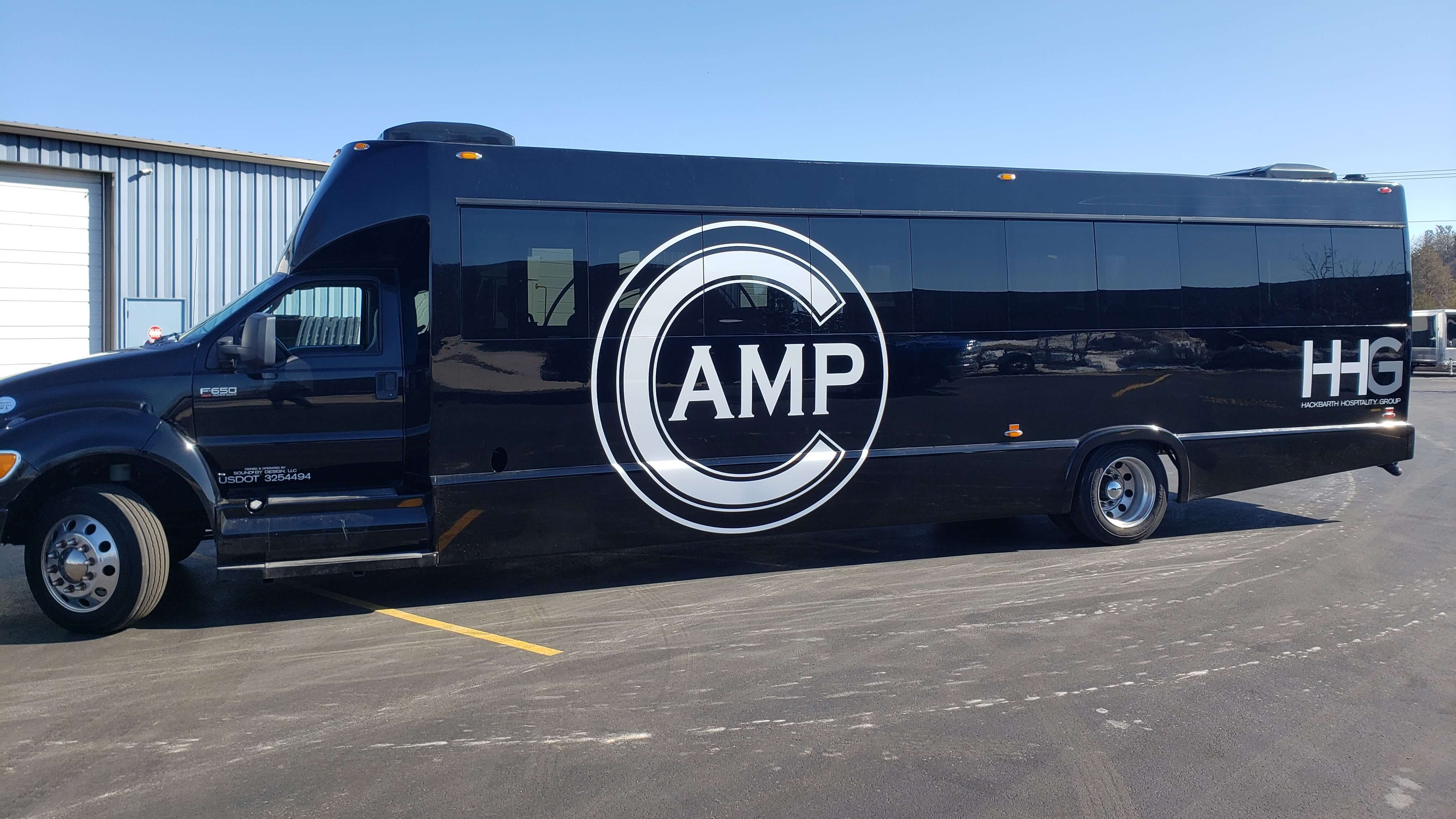 Custom Bus Wrap with full color print on the side of the vehicle designed and printed by Signs and Lines