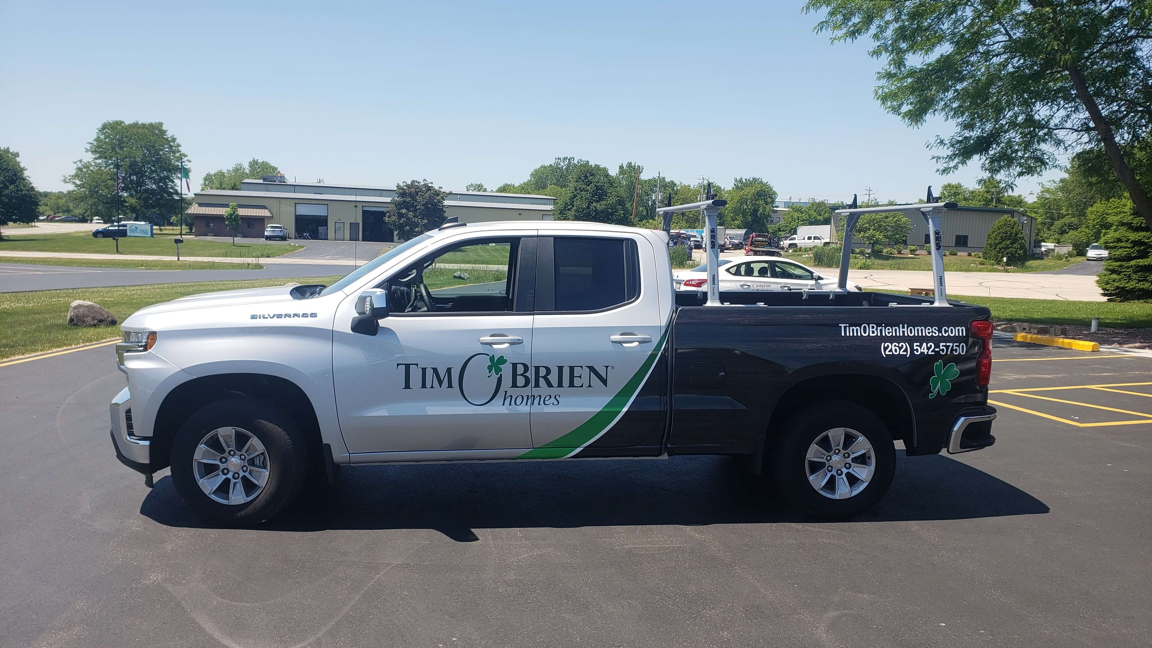 Tim O Brien Homes Partial graphics on the doors and rear of a Ford-F150