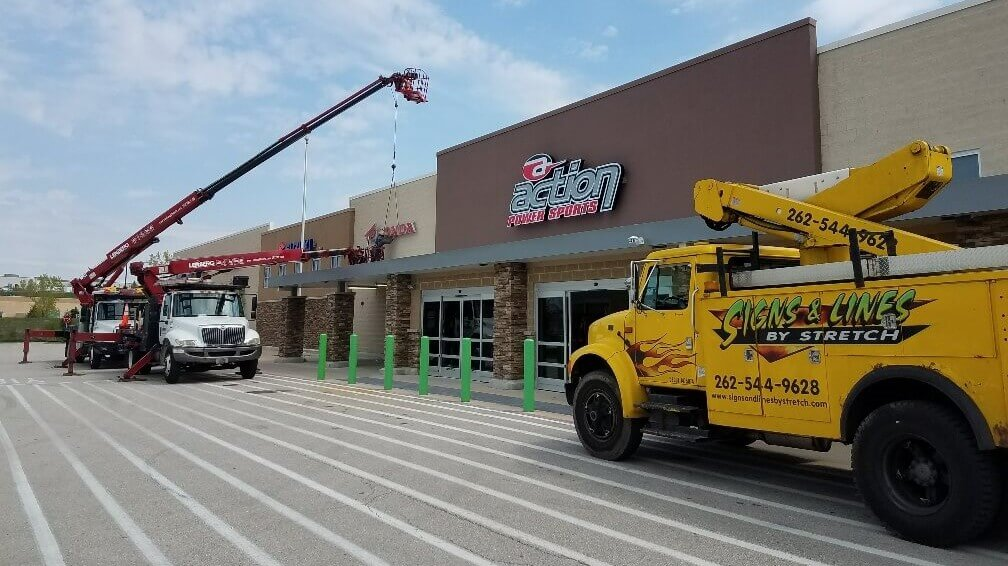 Wholesale Sign installation for Olympus Group and Cafe Hollander by Signs and Lines