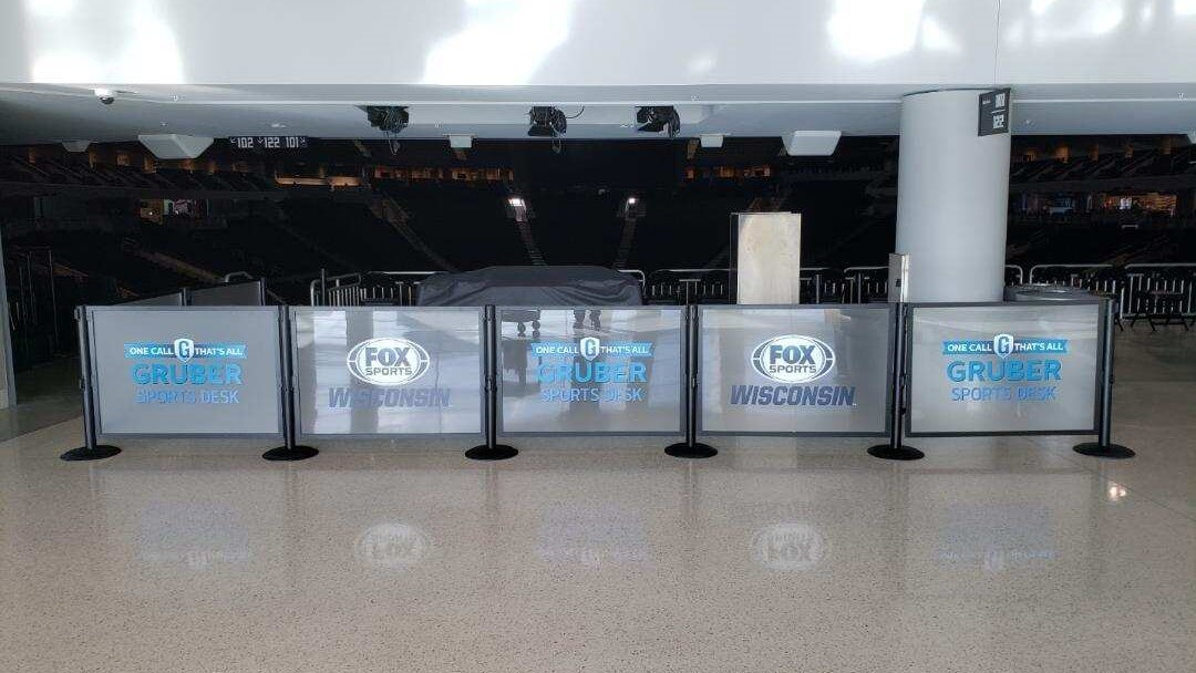 Fox Sports Wisconsin Fiserv Forum Box separation decals on walls for separation of staff