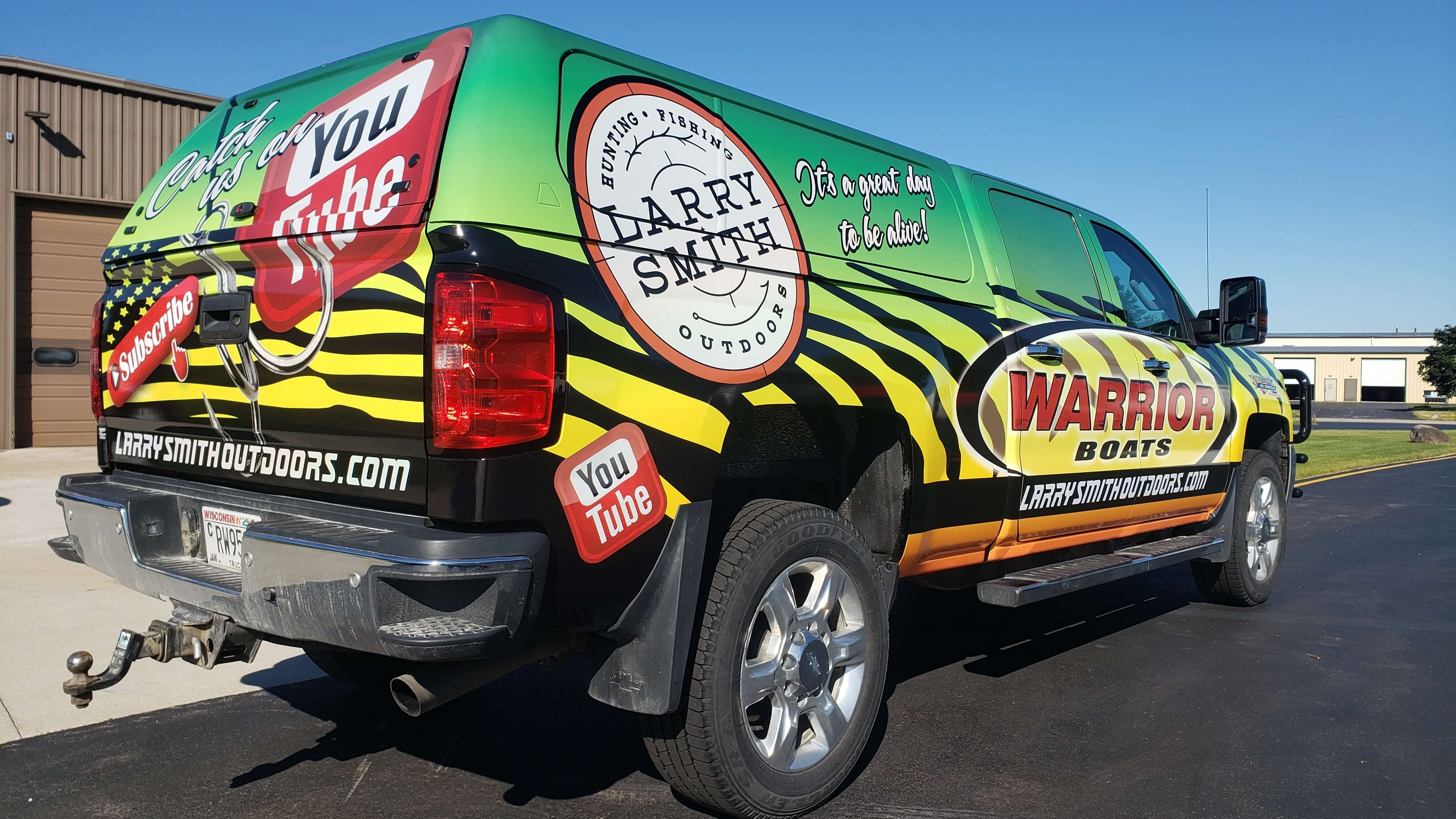 Larry Smith Outdoors Full Wrap with Custom Logos, Colors, and Boat Anchor on the Vehicle