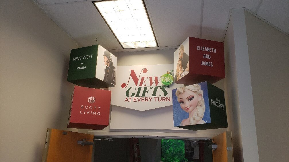 Hanging Signs for Christmas promotions at retail shop in Southeastern Wisconsin