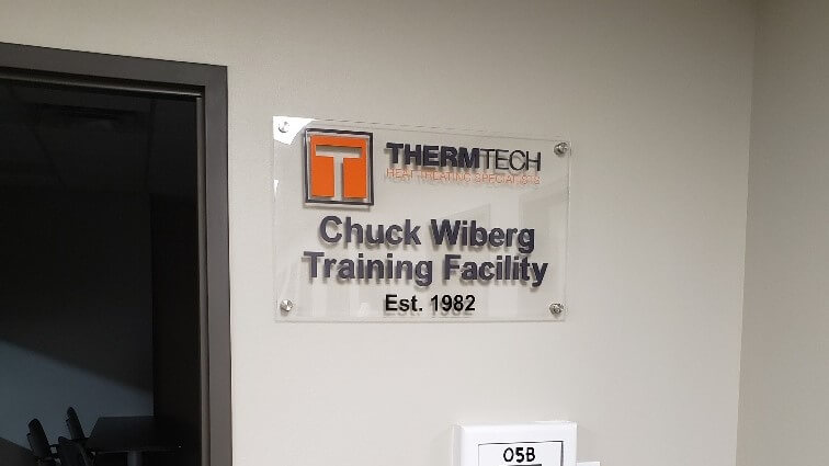 Custom Wood Cut Signs in interior application with printed photos of company history