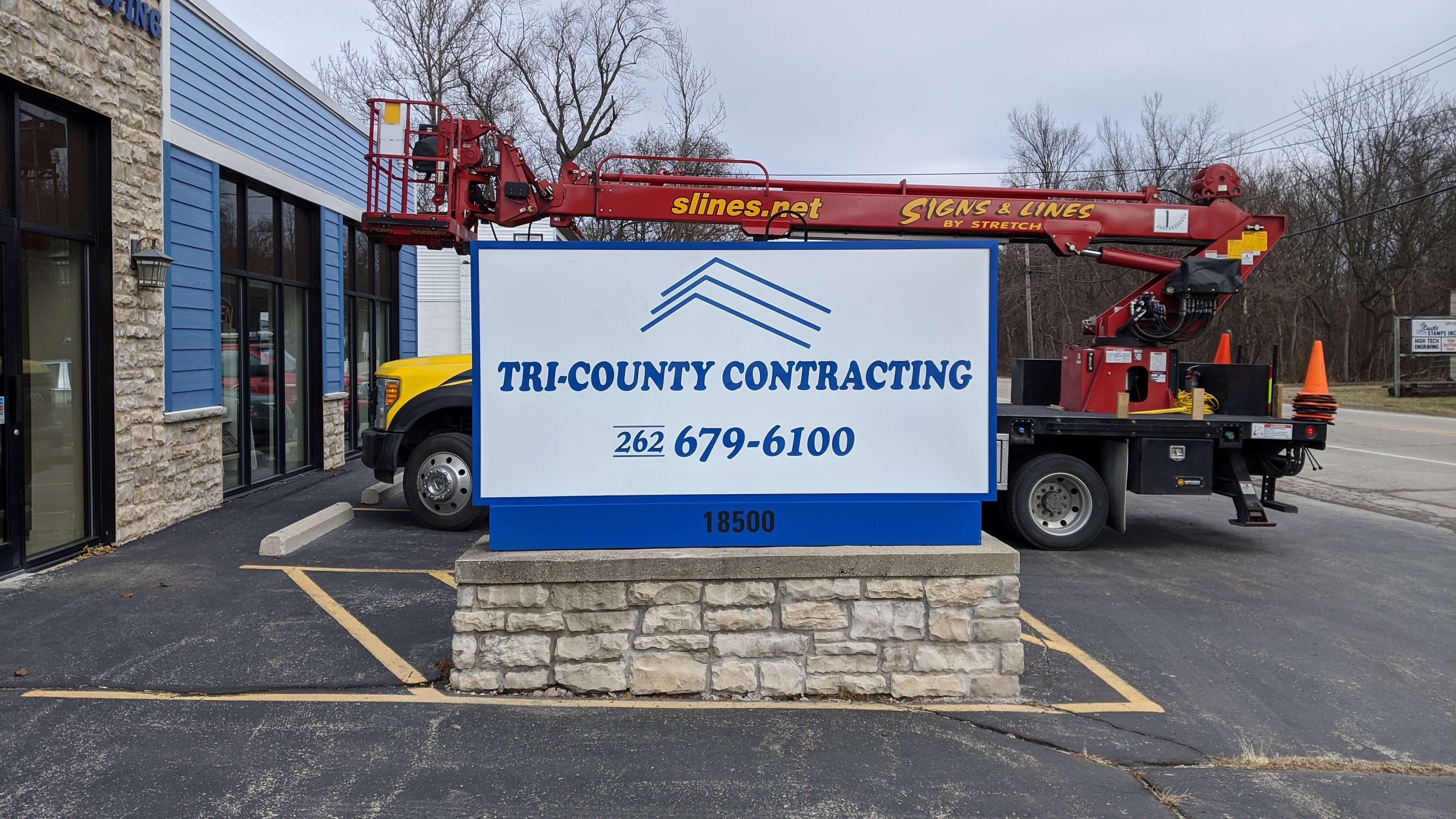 Tri City Contracting Monument Sign with LED lights and simple logos on white background