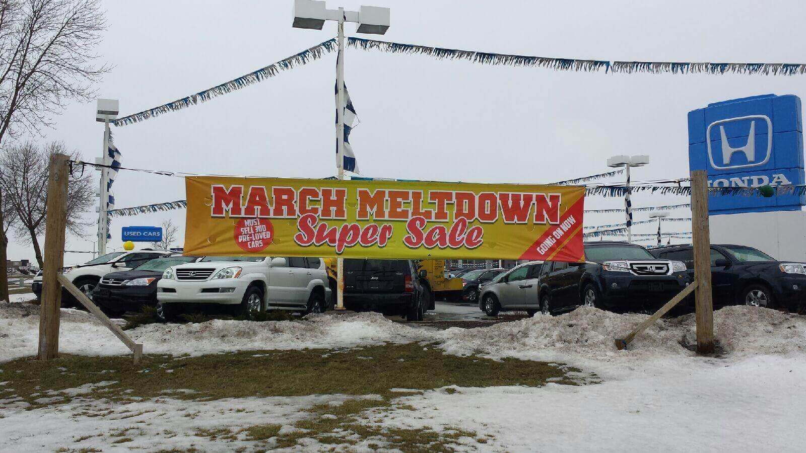 Temporary outdoor under construction banner for dodge dealership in Waukesha Wisconsin