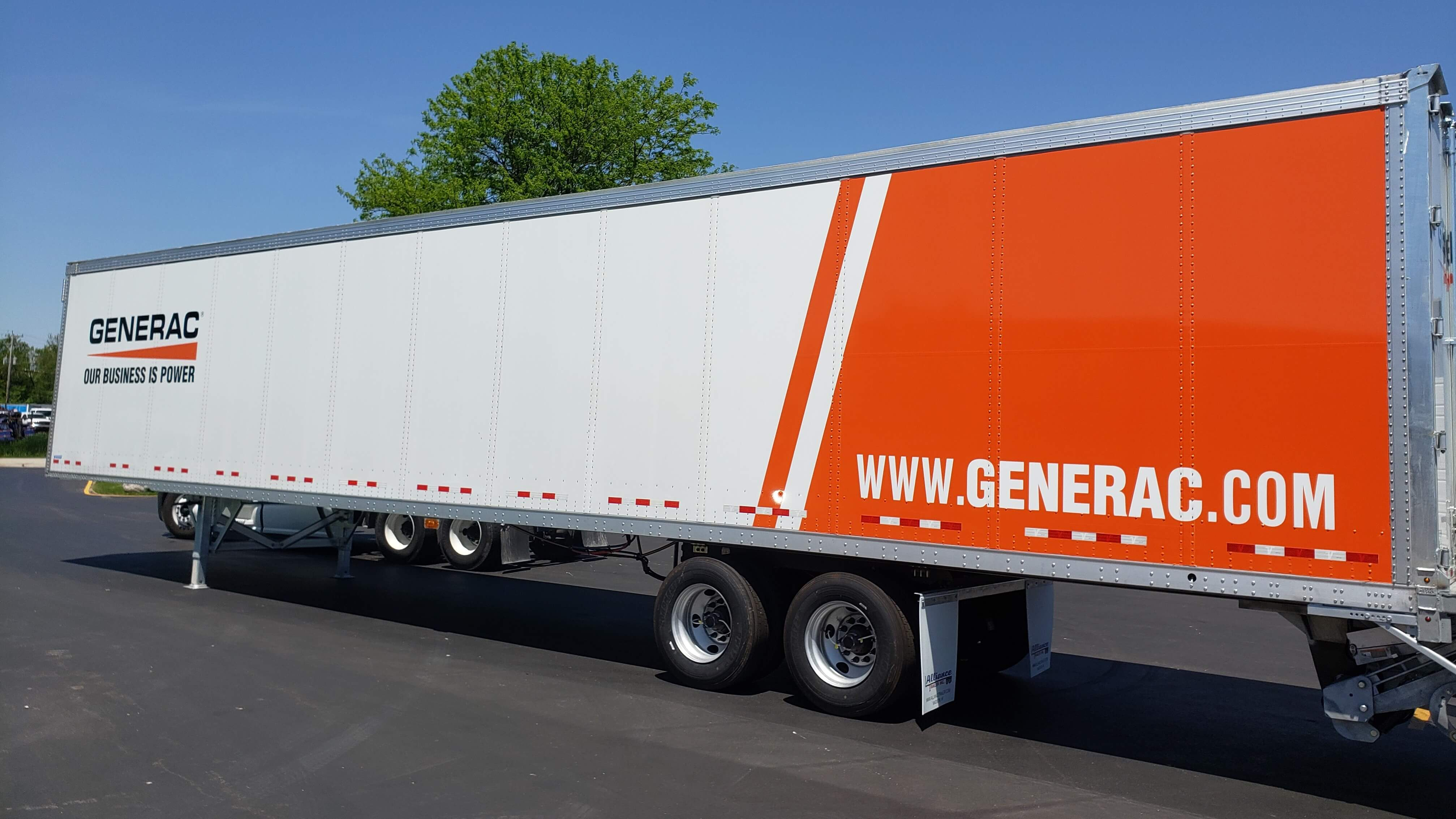 Generac Trailer wrap from the rear, with orange decals, website, and company branding