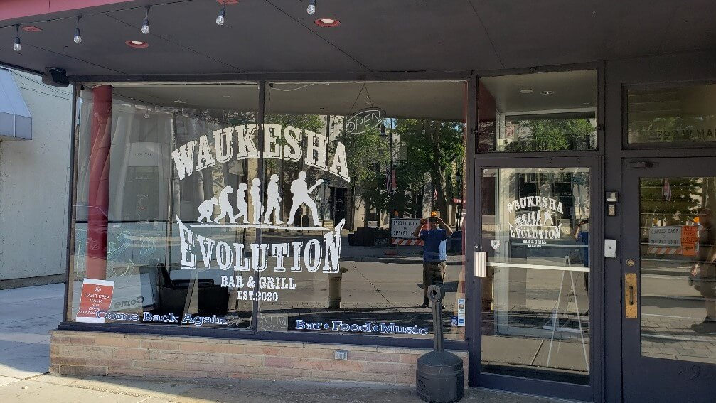 White, outdoor window graphics Waukesha Evolution restaurant storefront