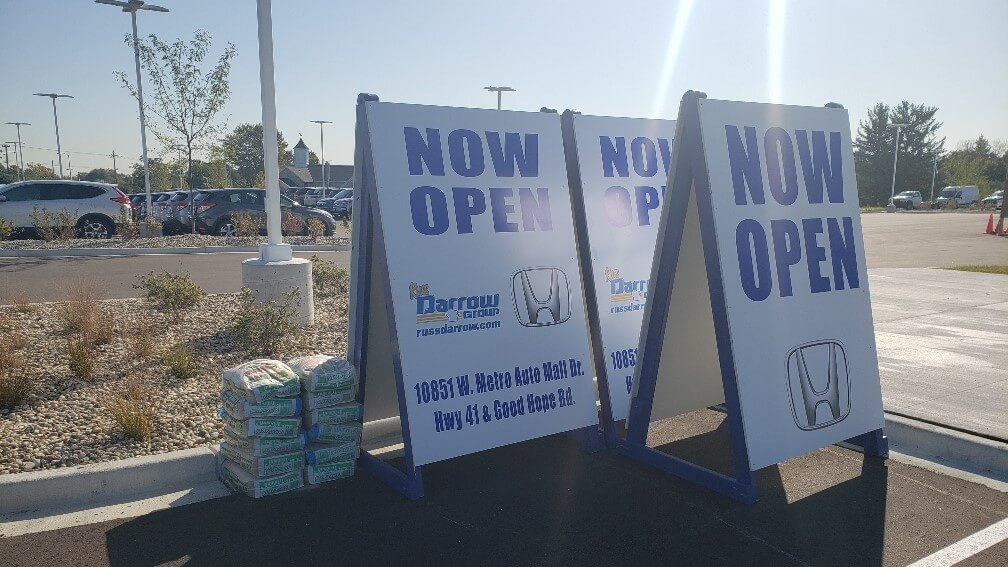 Honda Dealership custom made, large a frame sign painted in blue and white to promote operational hours