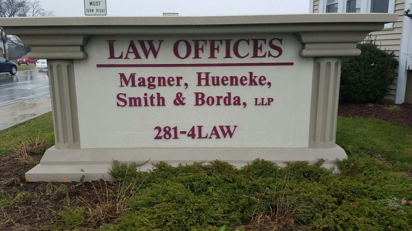 Domer Law Personal Injury Law Firm Lobby Sign designed and built by Signs and Lines