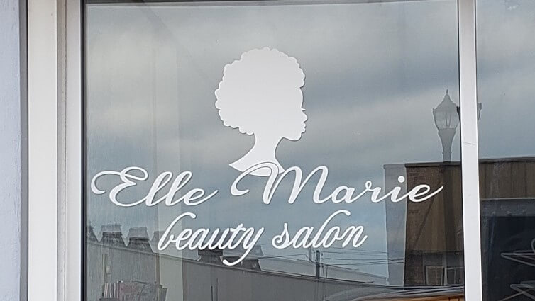 Elle Marie Beauty Salon Window Graphics on Storefront in white by Signs and Lines