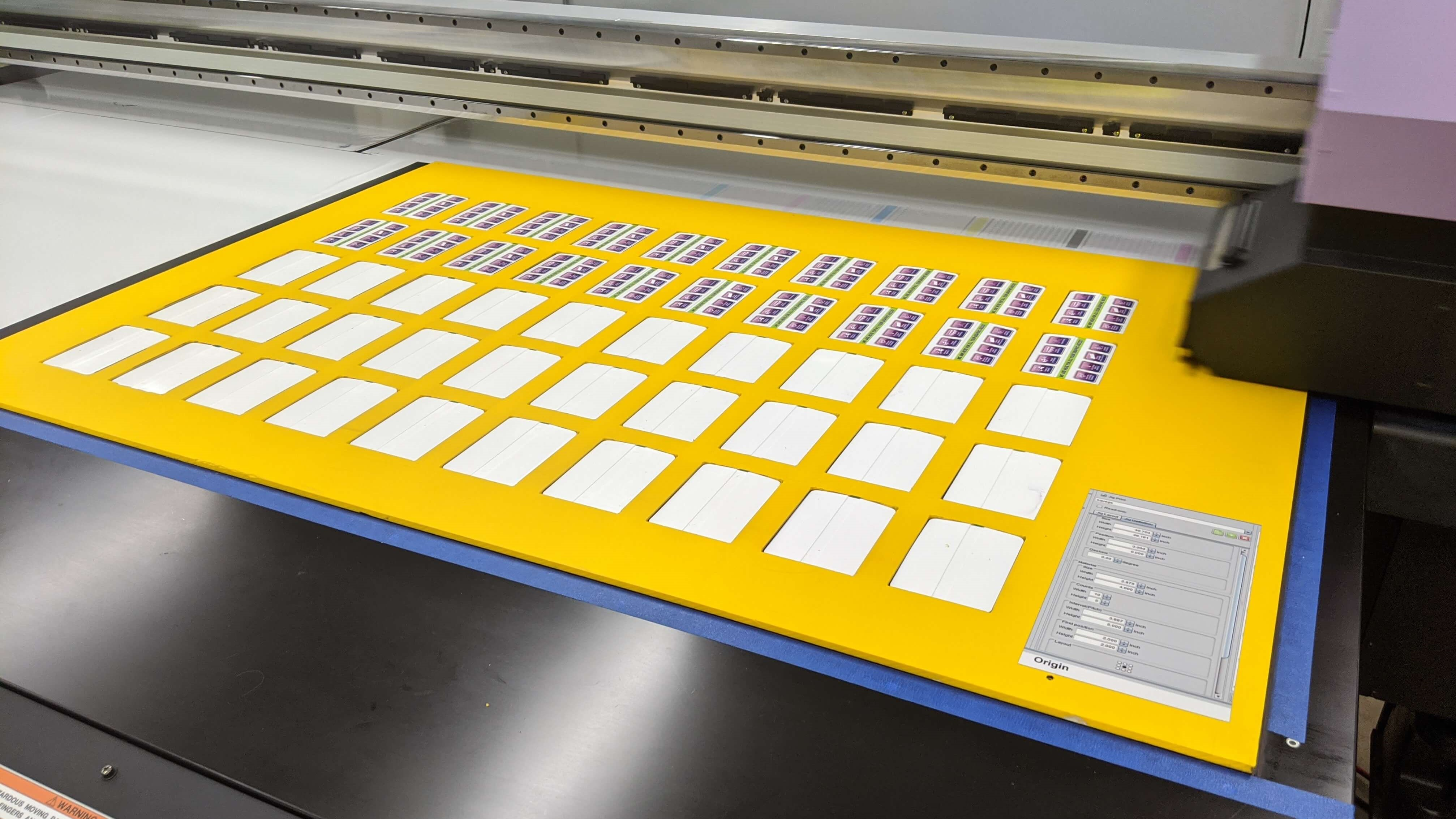 Stickers being Printed on our large, wide format UV printer at Signs and Lines by Stretch