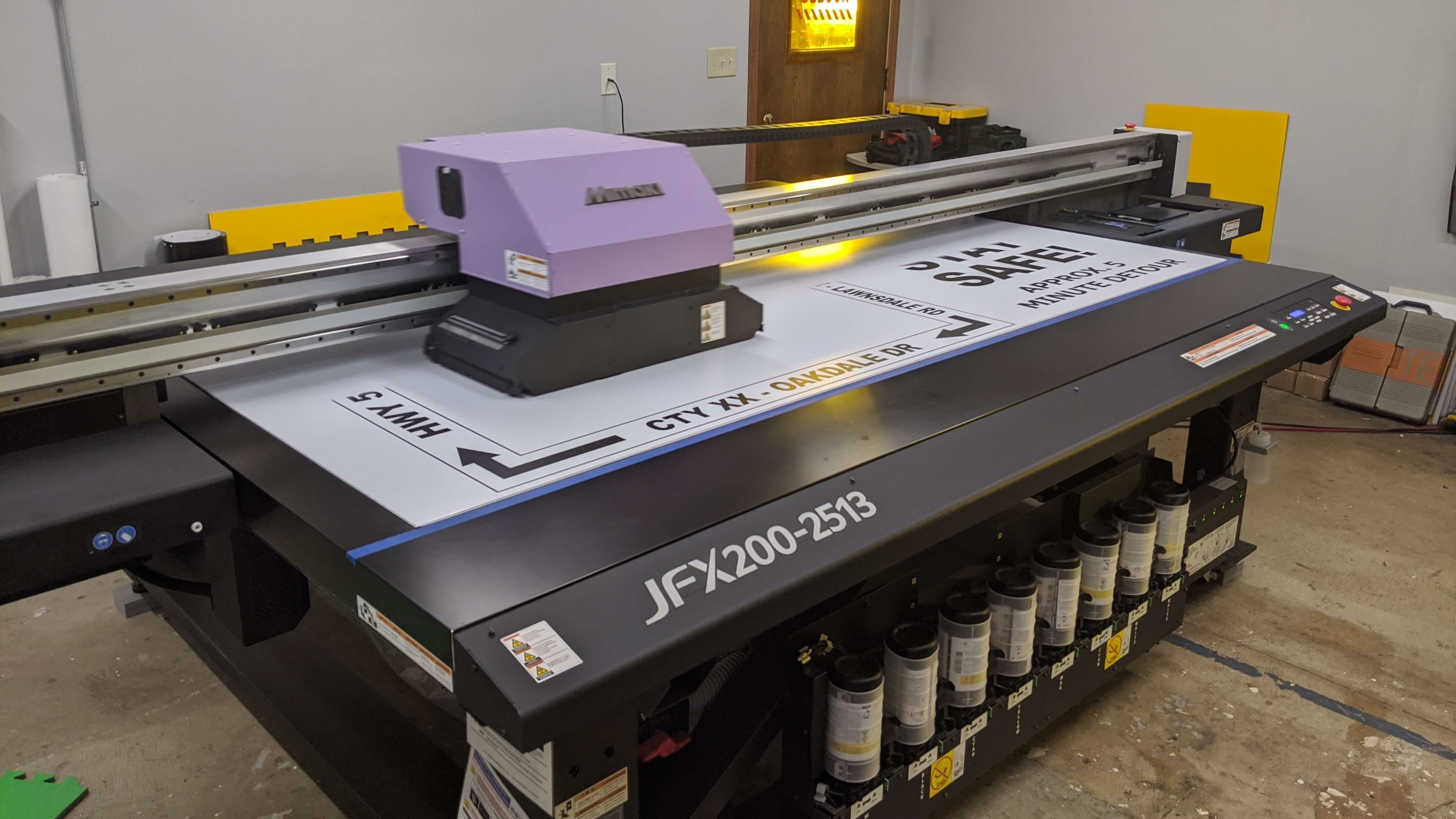 Our Mimaki JFX 2000 Printing out a large sign to be used on a road construction site