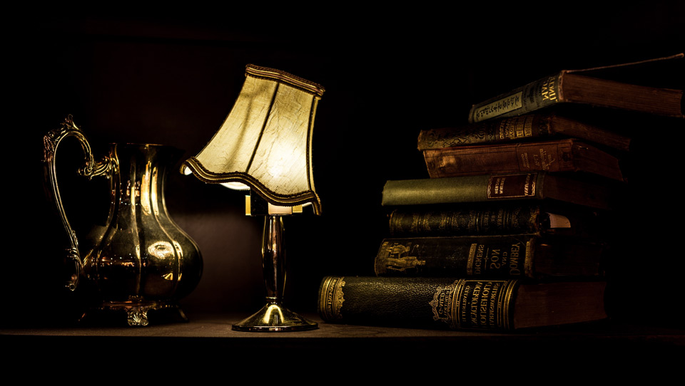 Lamp with pitcher and books