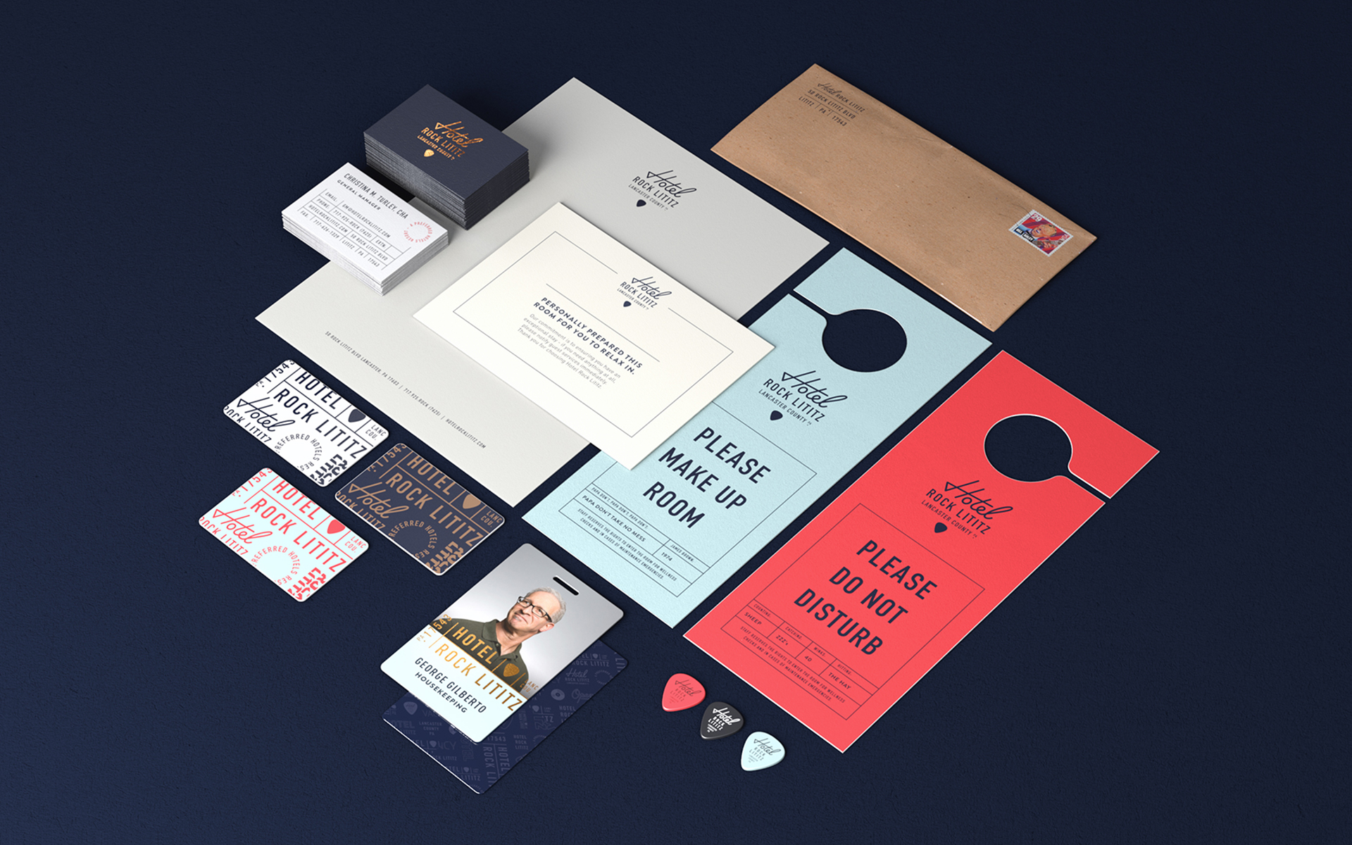 various Hotel Rock Lititz collateral including business cards, hotel keys, do not disturb signs and ID badges