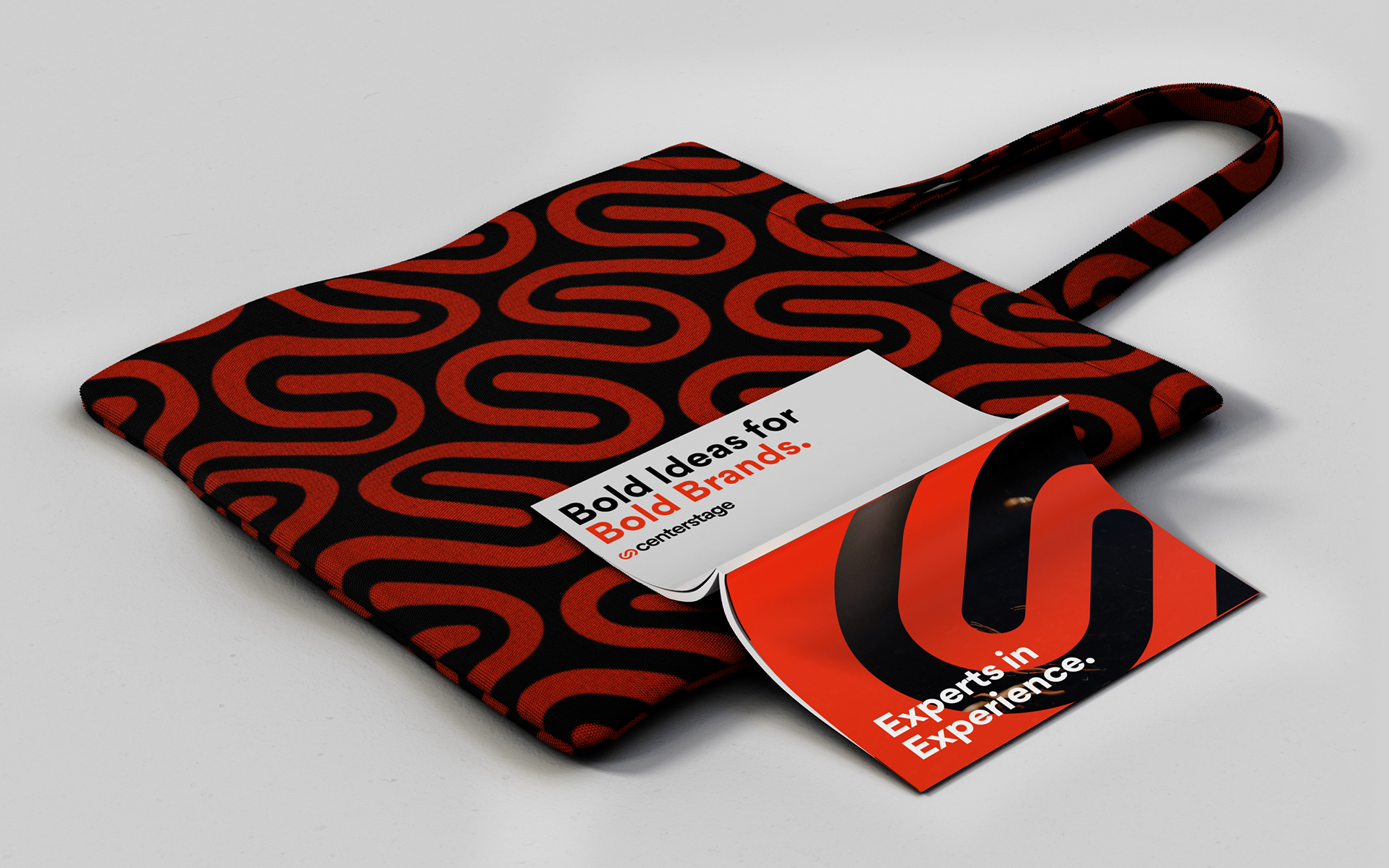 tote bag featuring patterned Centerstage logo with book laying open on top