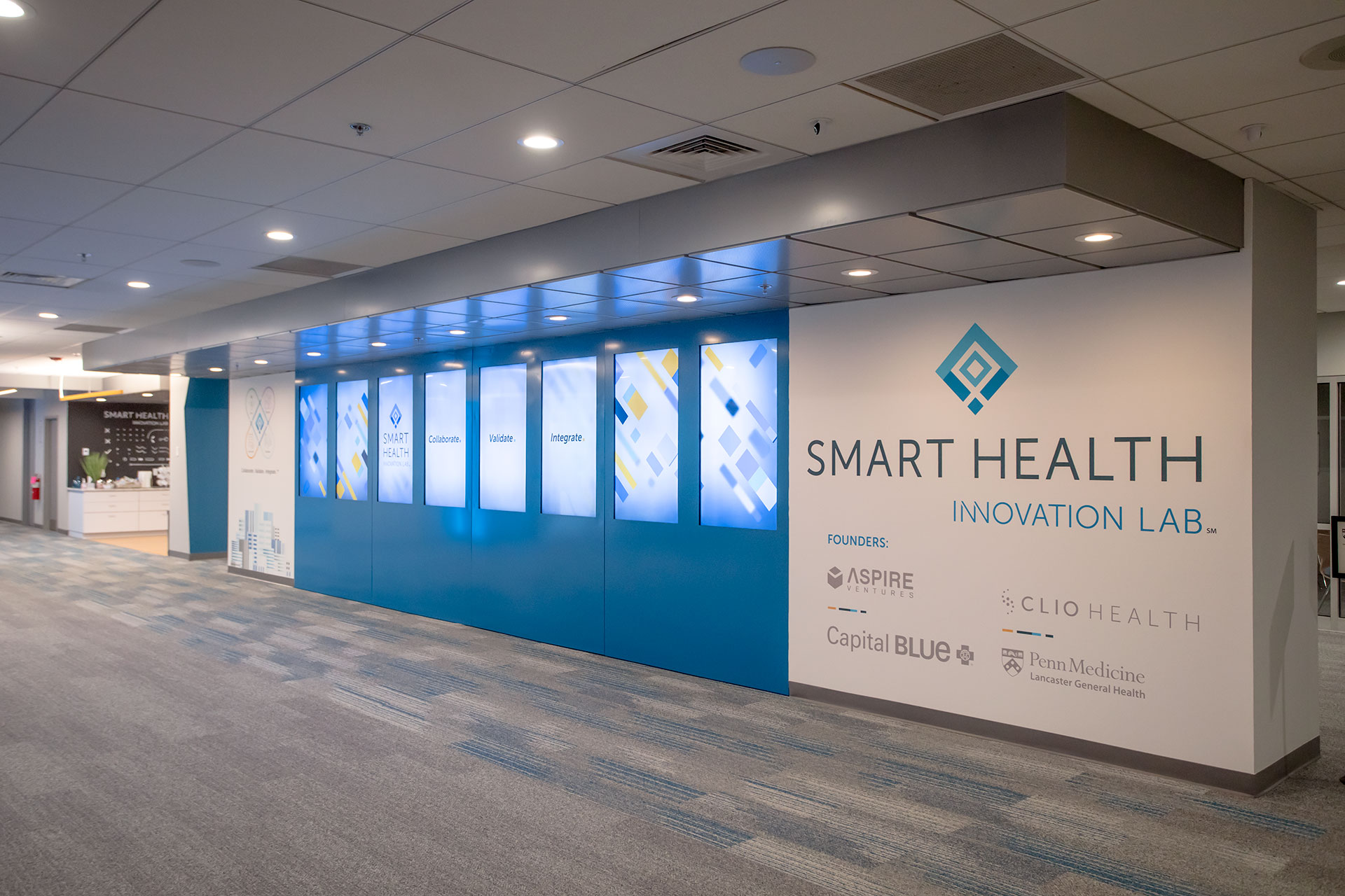 Smart Health Innovation Lab's lobby, feature 8 TVs in vertical orientation