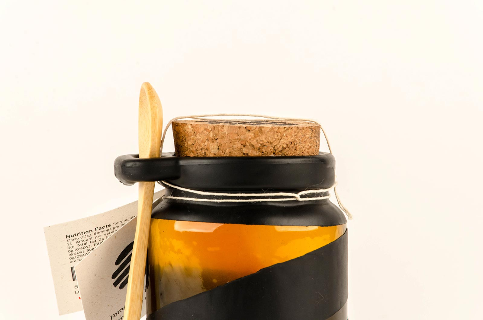 Coffee, bread, and Harvest Honey jar in modern photoshoot in Chicago showcasing the design for startups in chicago including packaging design, branding, product design, and photography