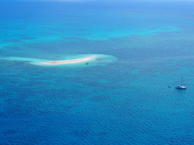island middle of the blue ocean
