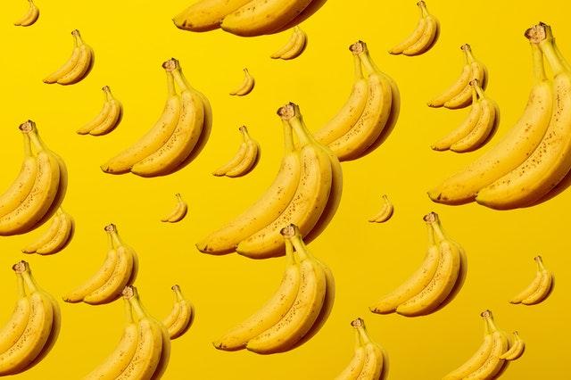Banana on yellow background