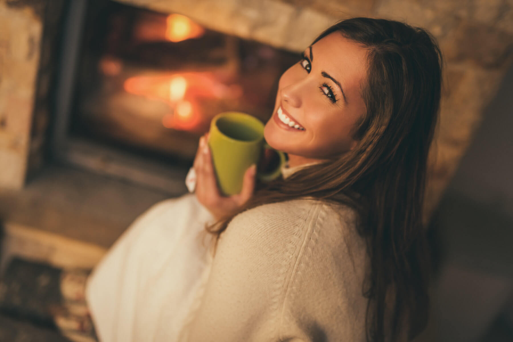 Happy woman near fireplace jacksonville