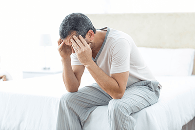 Man suffering with early signs of an enlarged prostate