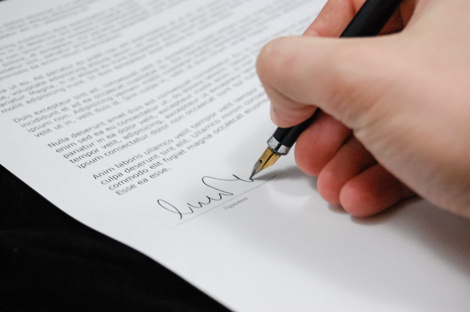 Person Signing in Documentation Paper