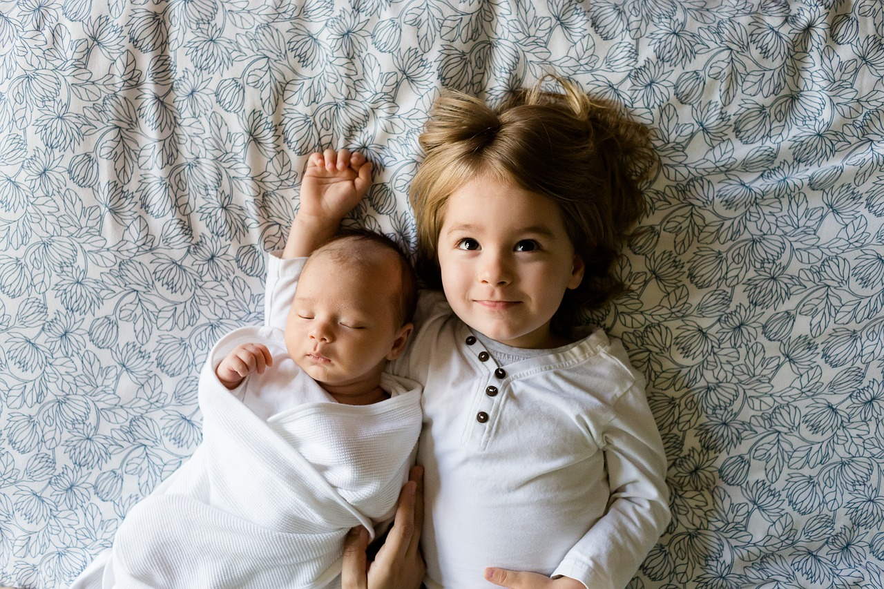 children laying on a bed