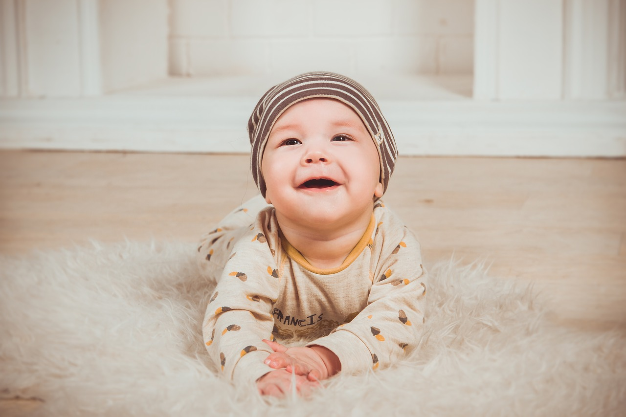 baby smiling on the carpet