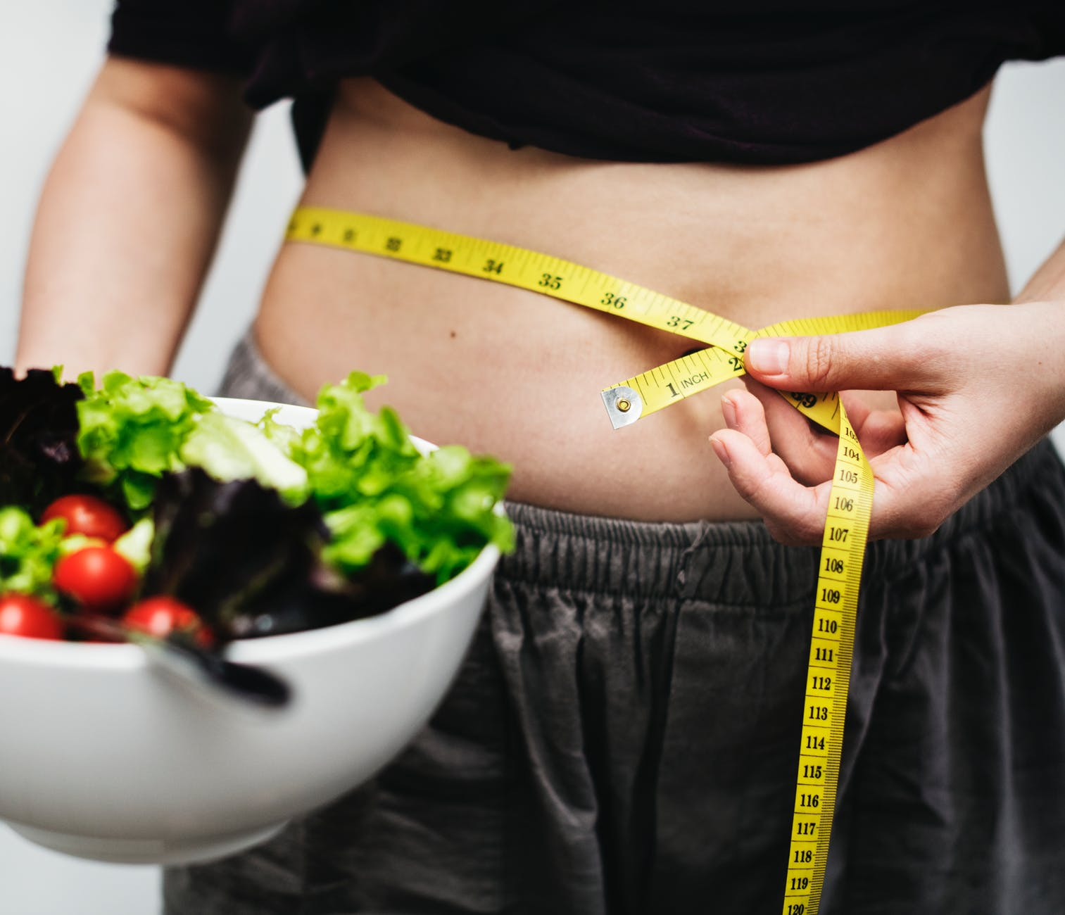 waist measuring with a healthy salad